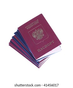 Stack of russian and US passports with russian passport on top