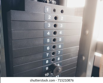 Stack of rusty metal weights in gym. Gym equipment.
