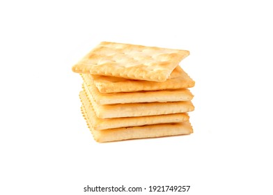 Stack of Saltine crackers isolated on white background.