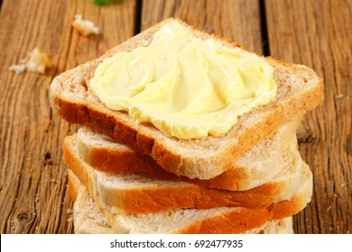 Stack of sandwich bread slices with butter