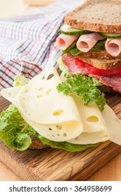 Stack of sandwiches with ham, cheese salami