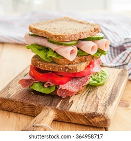 Stack of sandwiches with ham and salami