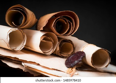 Stack of scrolls of parchment on the background of old papers