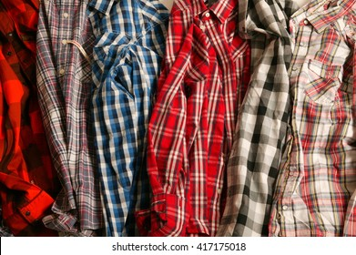 stack of shirts, stack of checked shirts