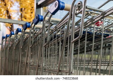 Stack of shopping trolleys with autumn background