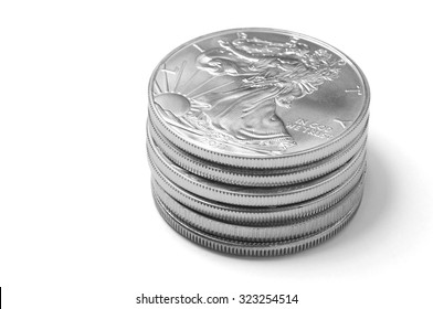Stack of Silver Eagle Coins on White Background