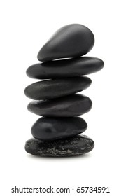 stack of six black pebbles in balance, isolated on white