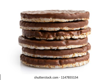 Stack of six chocolate rice cakes isolated on white.