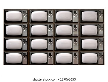 An stack of sixteen old vintage tube televisions with wood trim and chrome dials on an isolated background