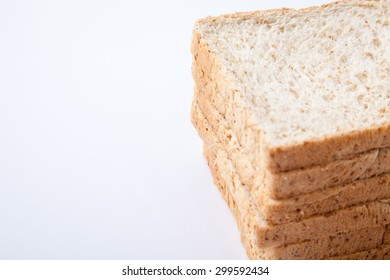 stack of slice whole wheat bread on white background