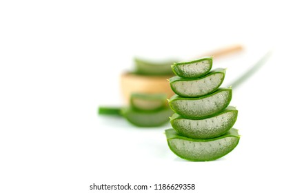 Stack of sliced aloe vera - herbal plant on white background