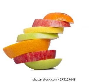Stack of sliced fresh fruit, isolated on white background