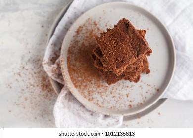 A stack of slices of healthy vegan brownies. Healthy dietary vegan dessert concept.