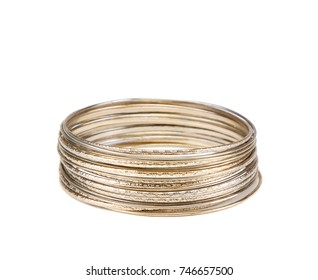 Stack of small gold bangles isolated on a white background. Indian bracelets.