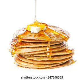 Stack of Small pancakes in syrup on white background