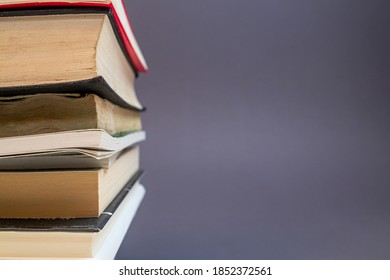 a stack of some books against a grey background