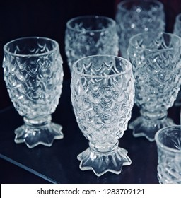 Stack of some drinking water glasses isolated object photo
