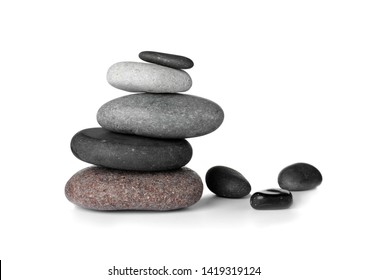 Stack of spa stones on white background