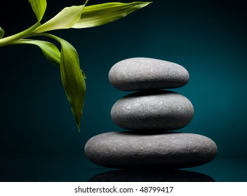 Stack of spa stones over color background