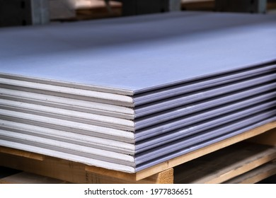 The stack of Special gypsum board with enhanced sound Acoustic insulation Plasterboard. Panel Type DF for indoor concrete walls prepared for construction