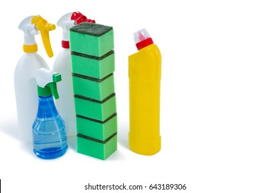 Stack of sponges with bottles against white background