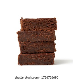 stack of square baked pieces of brownie chocolate cake isolated on a white background, delicious dessert, element for the designer