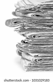 A stack of stacked newspapers on a white background