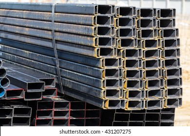 Stack of steel C chanel at construction site