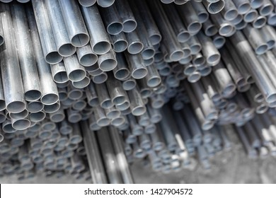 stack of steel electric conduit pipes,  selective focus, industry concept background