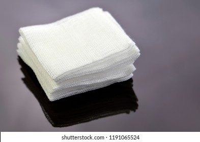Stack of sterile gauze pad on dark background.