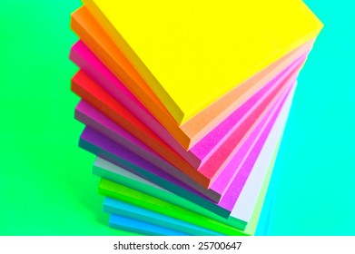 Stack of sticky note paper pads