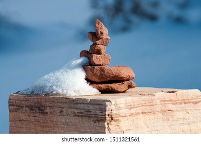 A stack of stones called a cairn marks a trail.