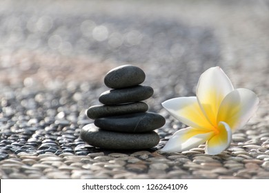 Stack of stones with Frangipani