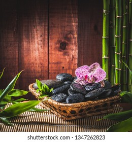 stack stones , pink orchid and bamboo