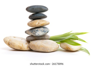 Stack of stones and some green leaves on the right. Very don't to earth and relaxed feeling.