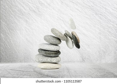 stack of stones while falling apart, abstract concept