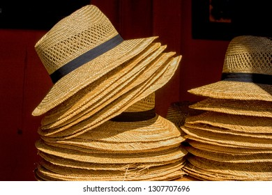 Stack of straw hats in the sun