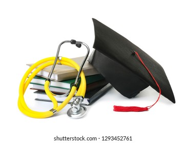 Stack of student textbooks, graduation hat and stethoscope on white background. Medical education