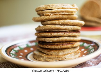 stack of sweet oat pancakes on ceramic plate