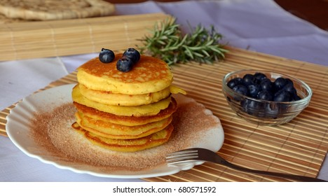 Stack of sweet pancakes with cinnamon sugar and blueberries.
