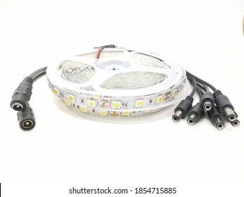 Stack of Tape Roll of Power Saving Energy Led Light Strip Type SMD 5050 12 Volt Isolated on White Background, Copy Space. This Modern Led Light Can be Used as Interior Lamp in Modern Home.