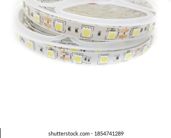 Stack of Tape Roll of Power Saving Energy Led Light Strip Type SMD 5050 12 Volt Isolated on White Background, Copy Space. This Modern Led Light Can be Used as Interior Lamp in Modern Home