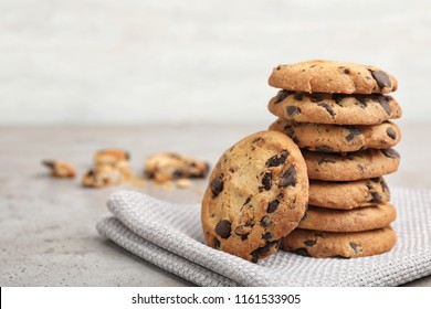 Stack of tasty chocolate cookies on gray table