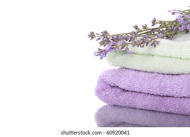 Stack of terry towels with lavender flowers and beautiful reflection
