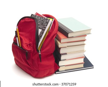 Stack of textbooks beside school backpack