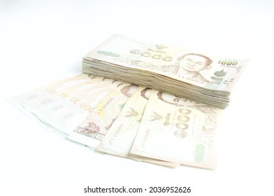 Stack of Thai Baht bank note on  white background.personal loan concept.