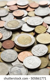 stack of Thai coins (Baht). over light [blur and select focus background]