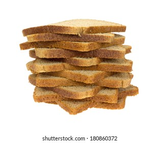 A stack of thin sliced wheat bread on a white background.