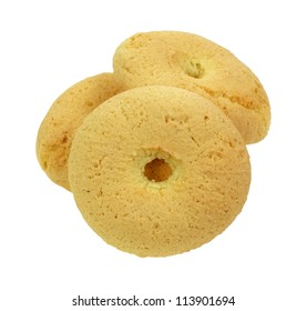 A stack of three golden brown snack biscuits.