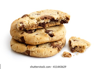 Stack of three light chocolate chip cookies isolated. One half with crumbs.